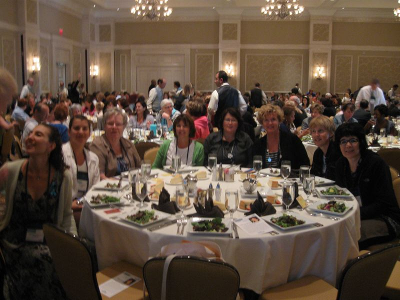 photo of Canadian attendees at the celebratoryluncheon - from right to left: Cathy McPherson (Ontario); Janet Montevecchi (Nfd); Teresene Walsh-Oakley (Nfld); Martina Reddick (Nfld); Bev Lanning (Nfld); Edith Mulhall (Man.); Kim Avanthay (Man.); and U.S. Heather Ferguson